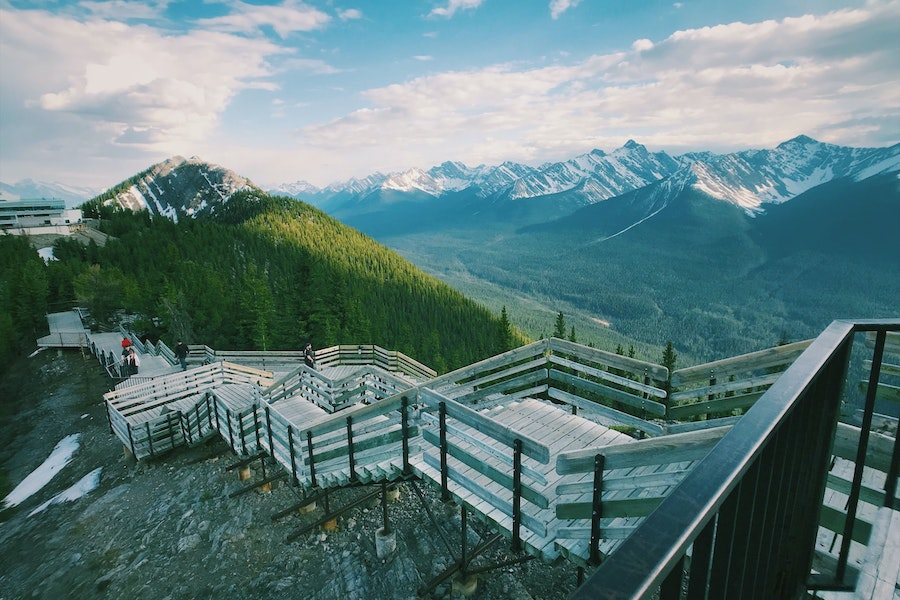 Wooden stairs with snow-capped mountains in the distance