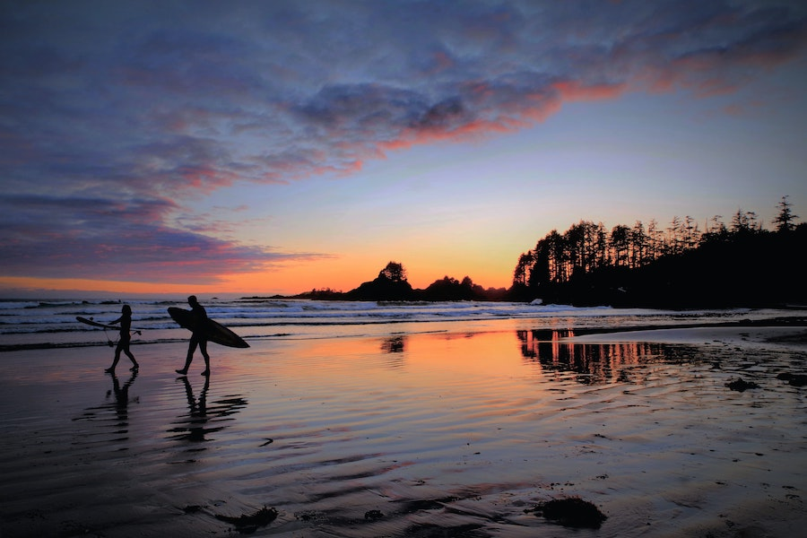 Sunset at a beach with surfers