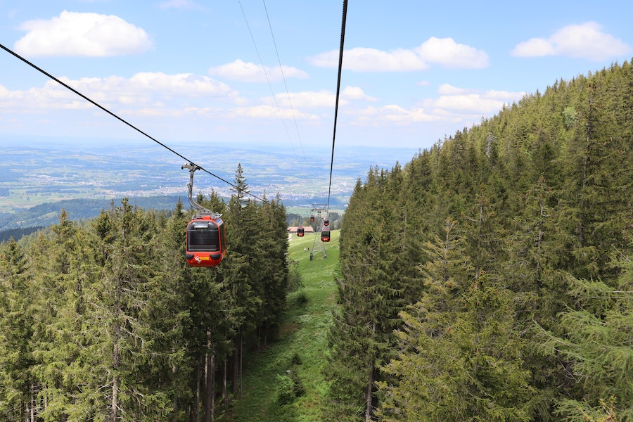 Cable cars going up a mountain