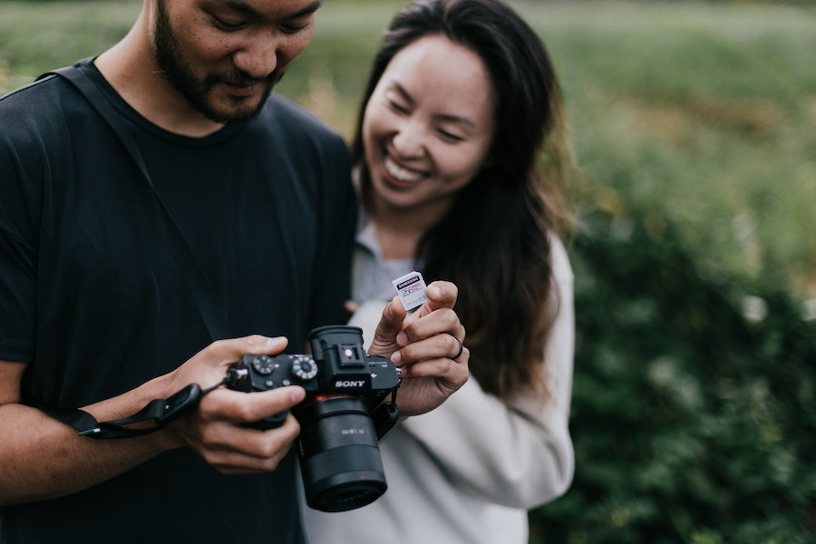 Two people looking at a camera