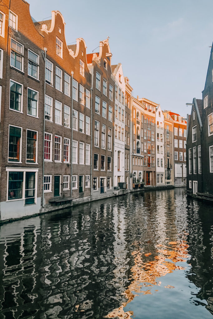 View of Amsterdam canale houses with a reflection on the water