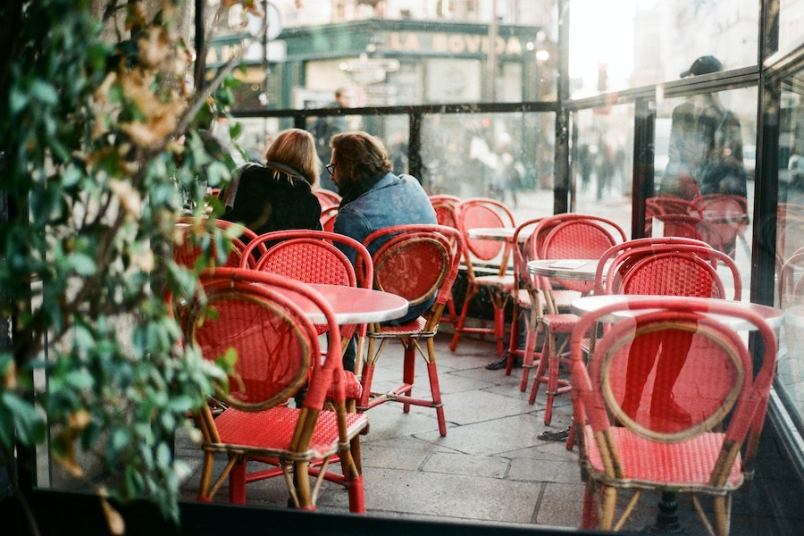 Couple sitting at a cafe in Paris