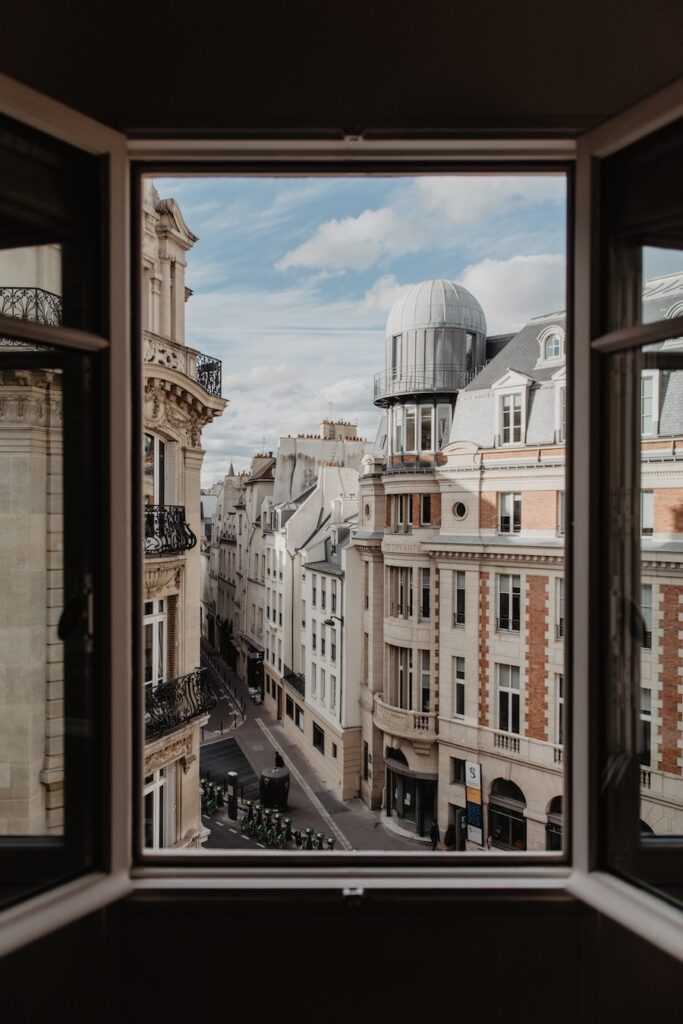 Window open with a view of Paris