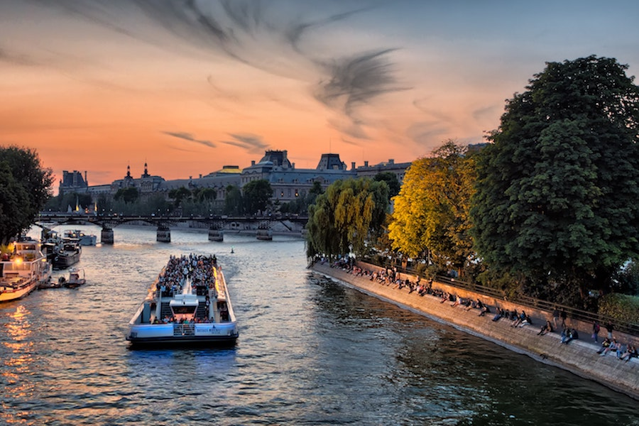 Cruise boat on the Seine river during sunset