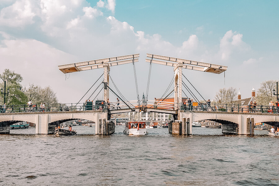 White bridge crossing a large river