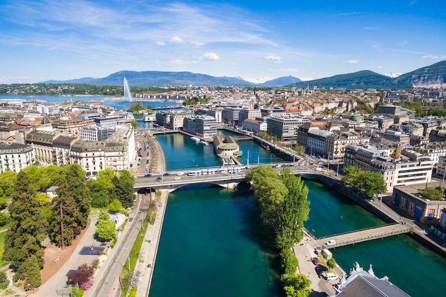 Aerial view of Geneva buildings and lake