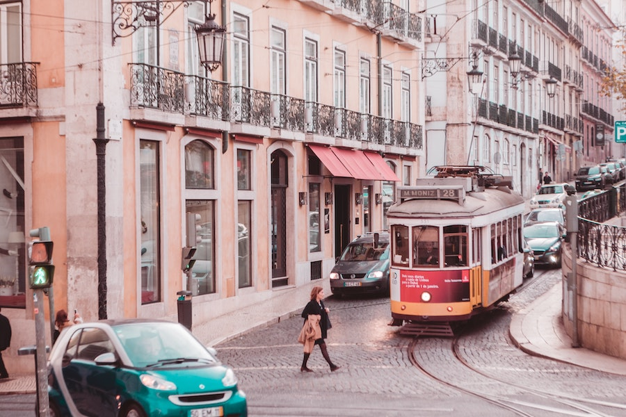 Pink hued buildings and a street car