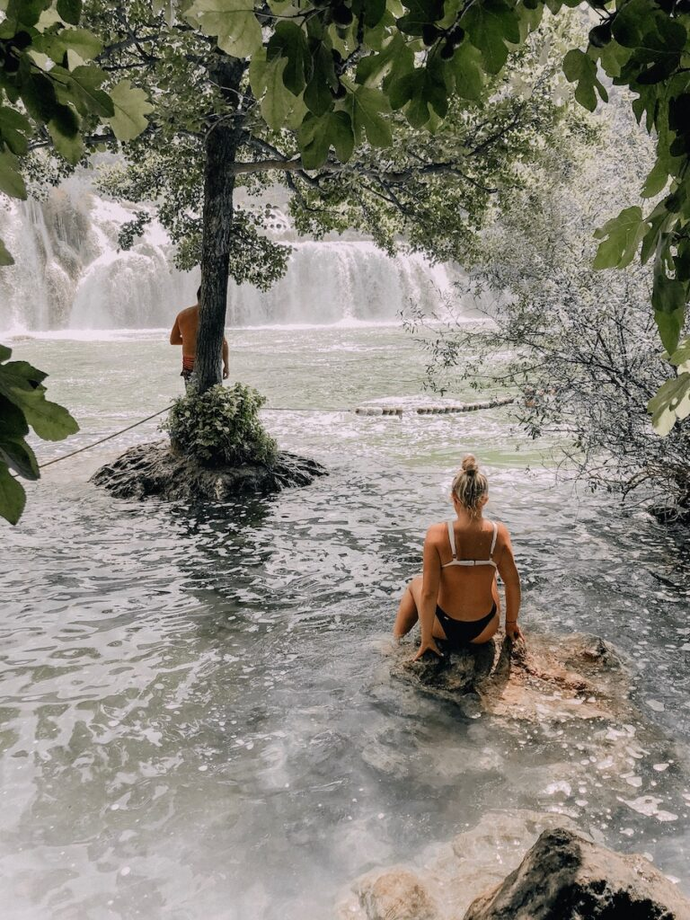 Girl sitting in the water
