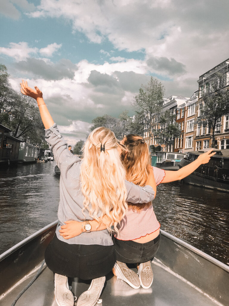 Two girls on a boat in Amsterdam