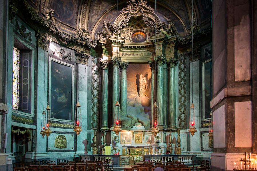 Dark church interior with stone detailing