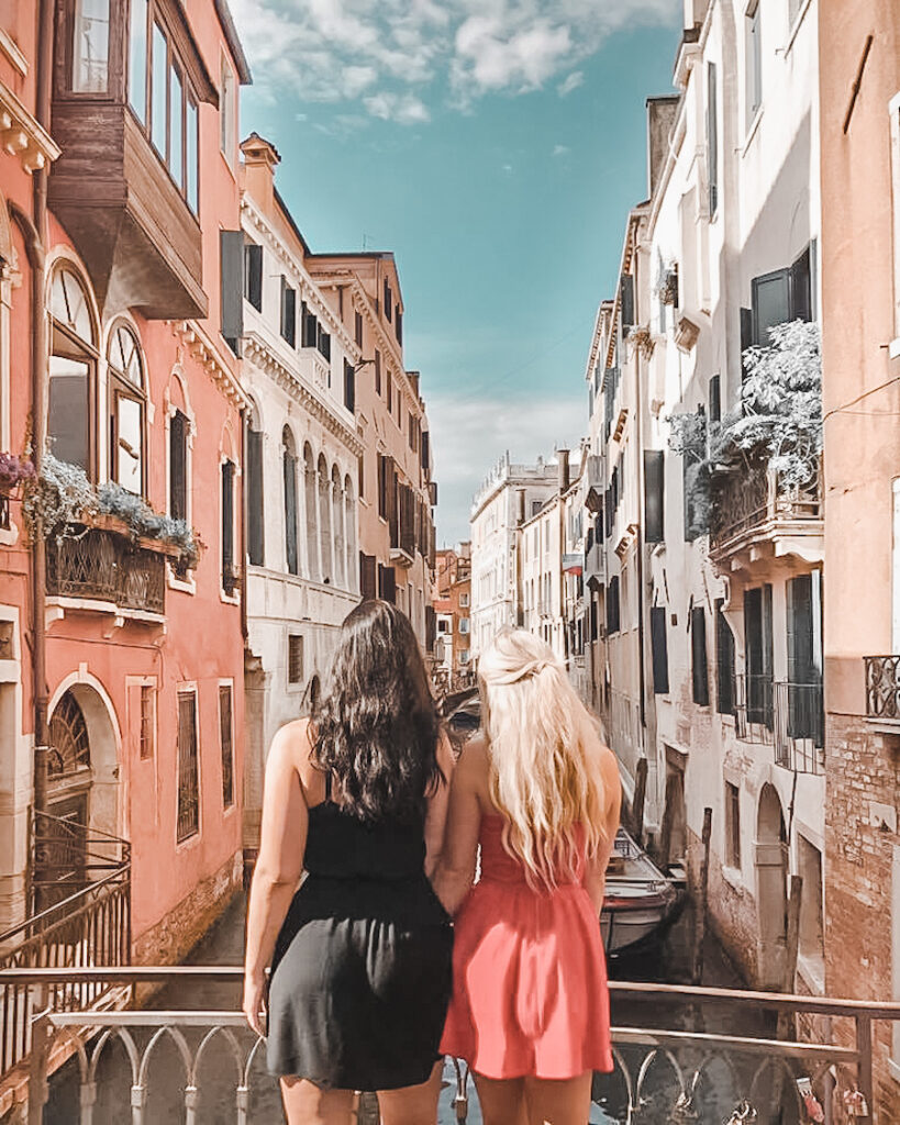 two girls standing on a bridge in Venice