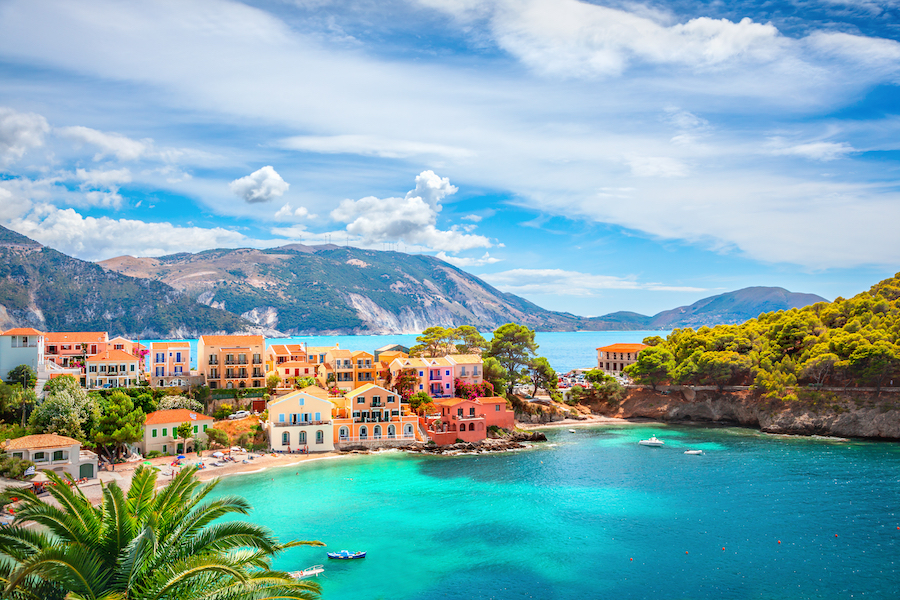 Colourful village with blue water