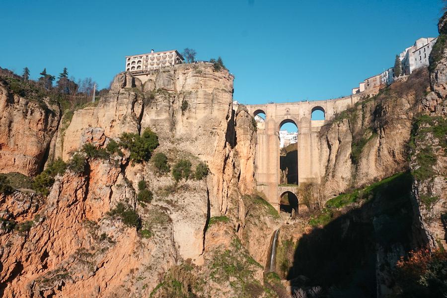Buildings built upon huge stone cliffs