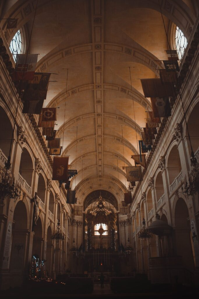 Dimly lit interior with church orange and high ceilings