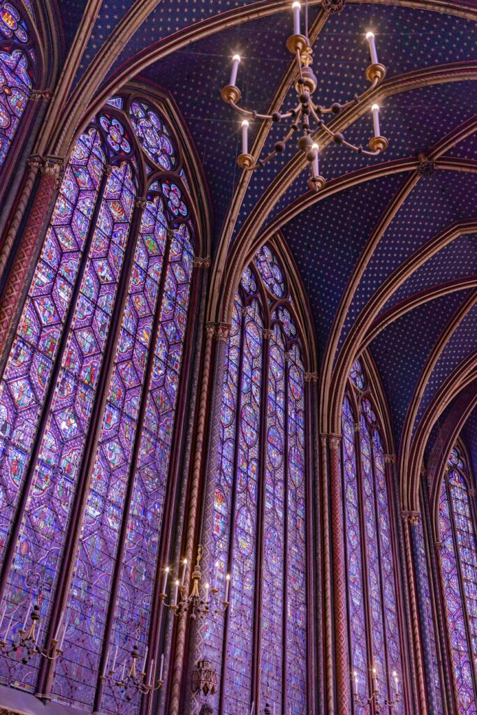 Huge stain glass windows in purple and other colours in one of the most beautiful churches in Paris