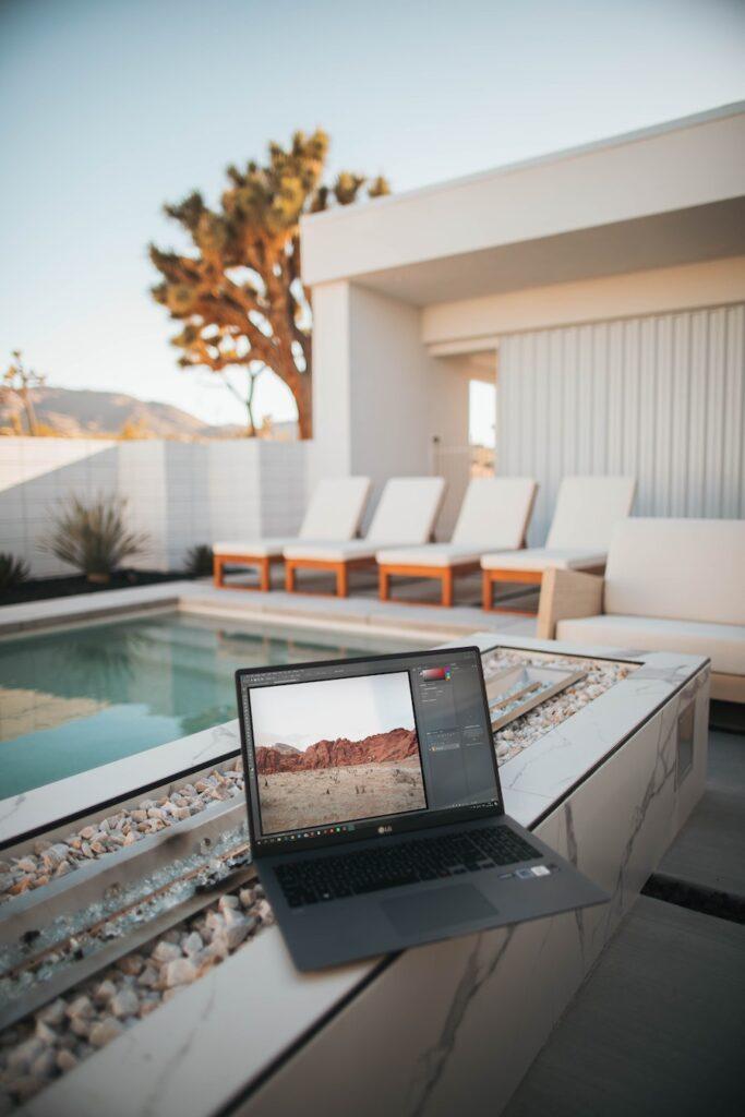 laptop overlooking a beach house resort
