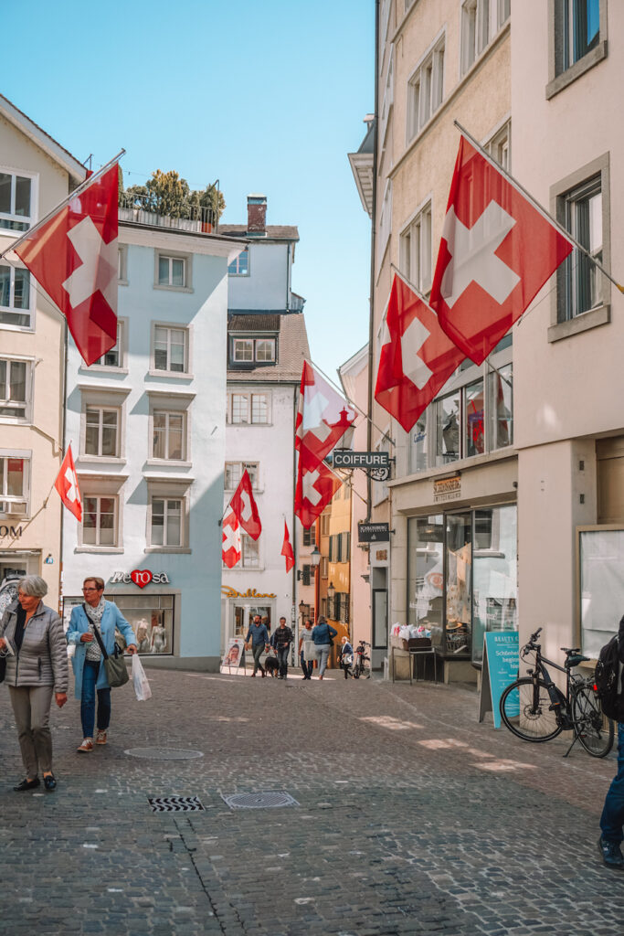 Street in Zurich with many Swiss flags