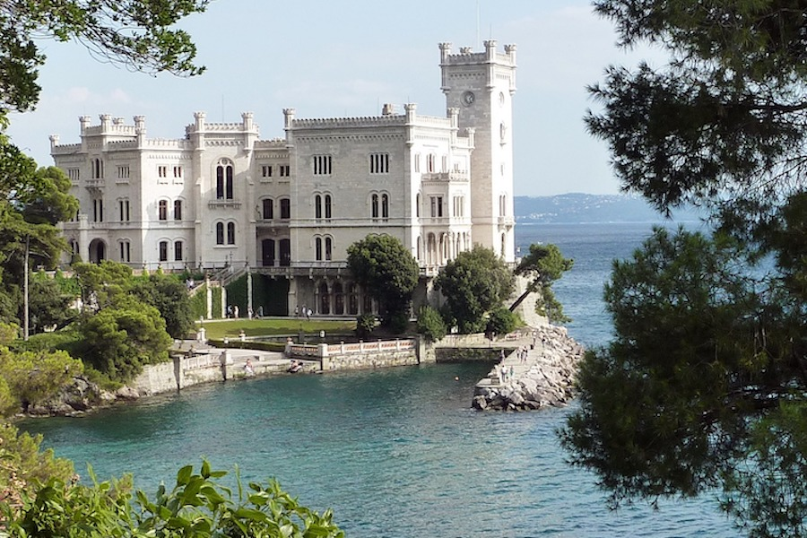 White stone castle along the water