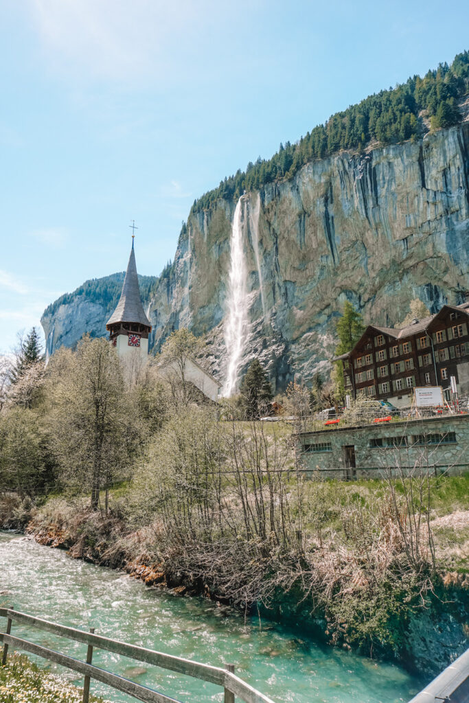 Village with waterfall over cliffs