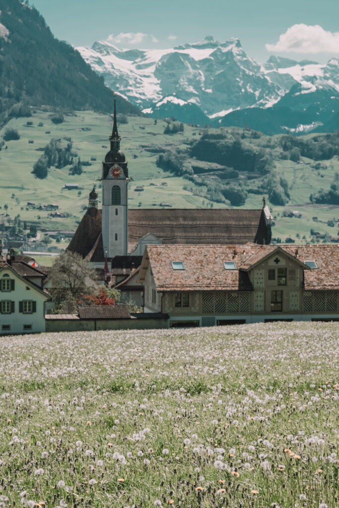 Village church with mountains in distance