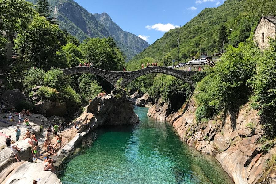 Stone bridge crossing blue water