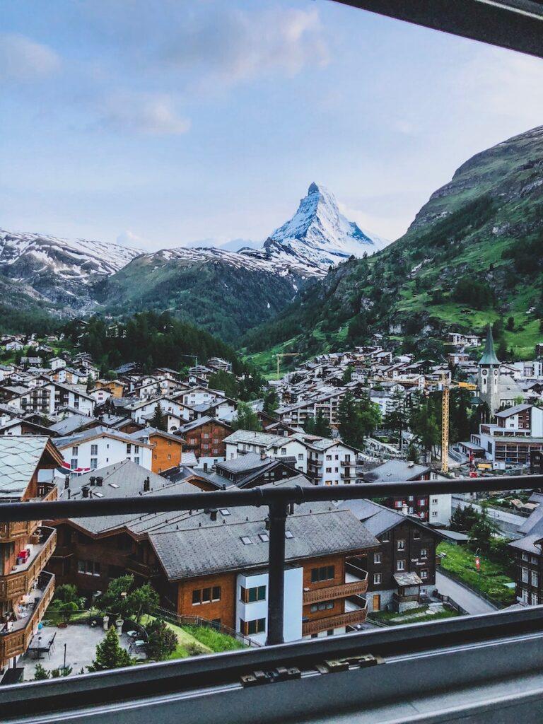 village with Matterhorn mountain peak in the distance