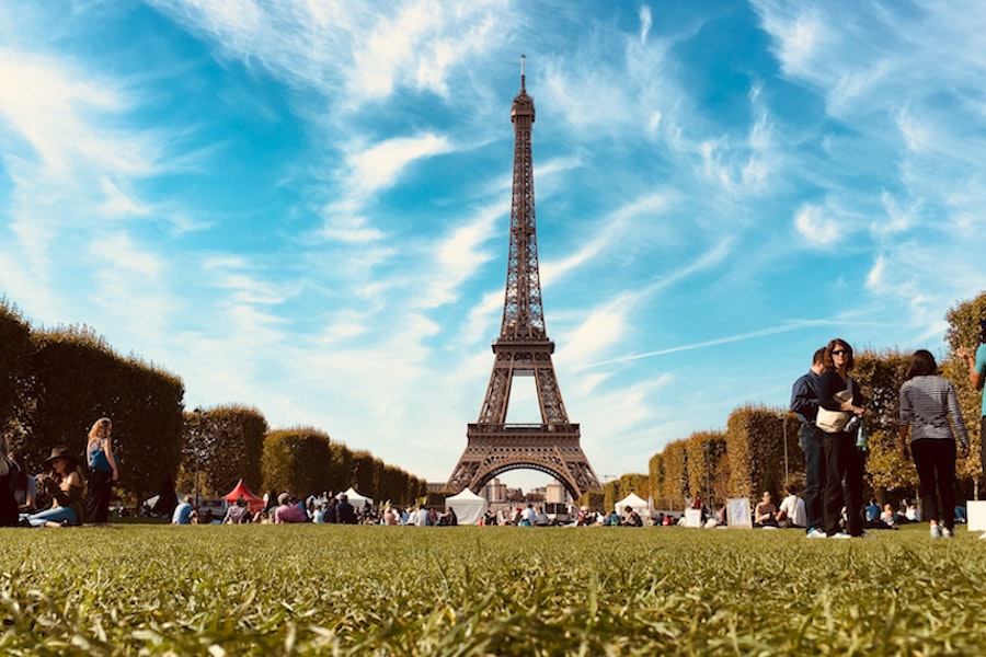 The park in front of the Eiffel Tower in Paris, which is often used as a prime spot for picnics.