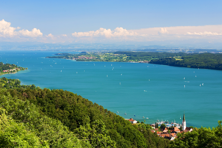 View on Lake Constance (Bodensee) with blue sky and the Alps in background