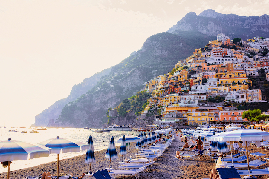 Positano, Italy - September 30, 2017: People on Beach in Positano town on Amalfi Coast and Tyrrhenian Sea in Italy in summer. Tourists and Beautiful Mediterranean view near Sorrento