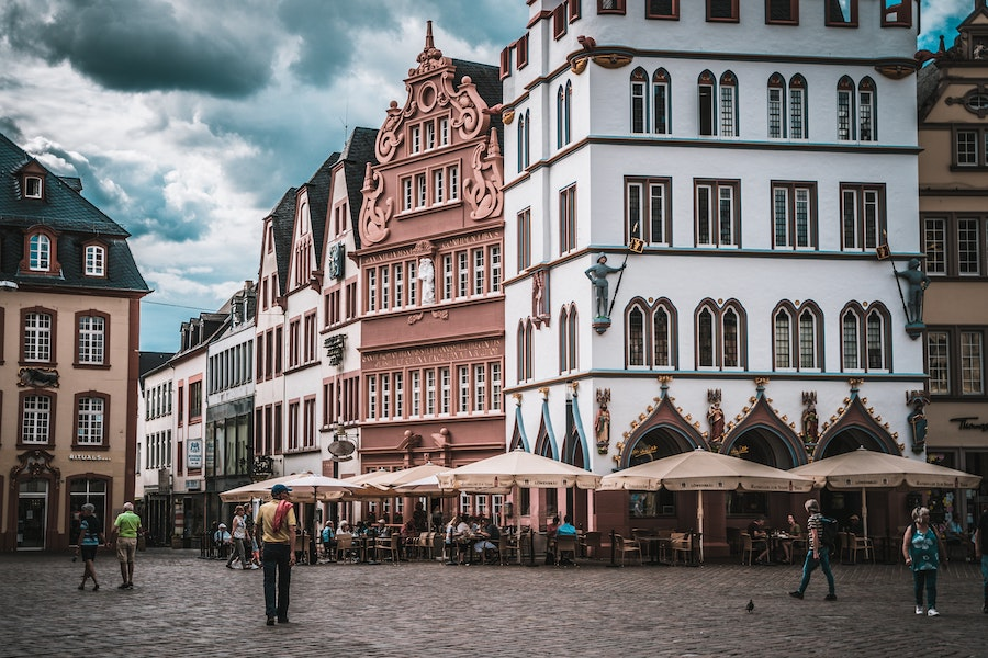 White and pink buildings in a cobblestone square