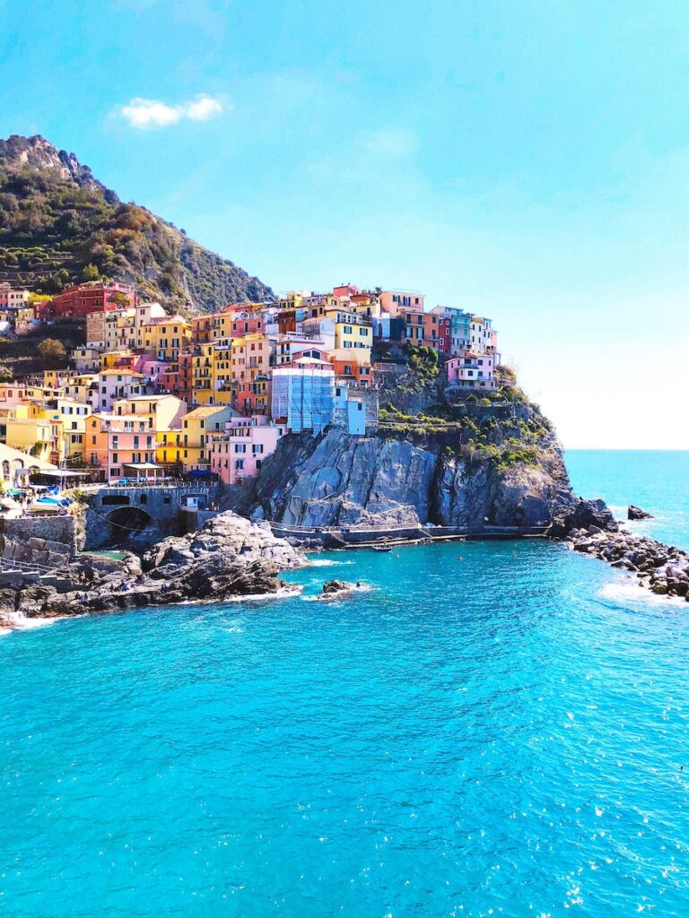 Brightly coloured houses on cliffs along the water