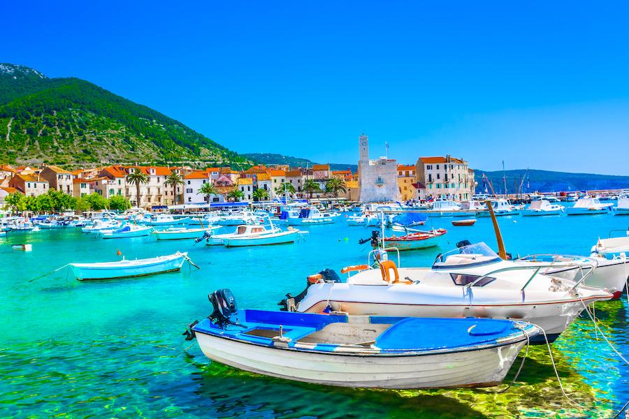 Seafront view at coastal town Komiza on Island Vis, summer travel resort in Croatia, Mediterranean.