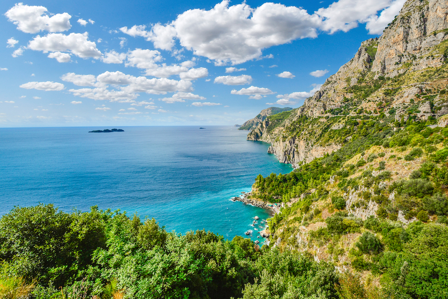 A view from the famous Amalfi Coast drive road towards the cliffs, mountains, coastline, beaches and Mediterranean Sea near the town of Sorrento, Italy